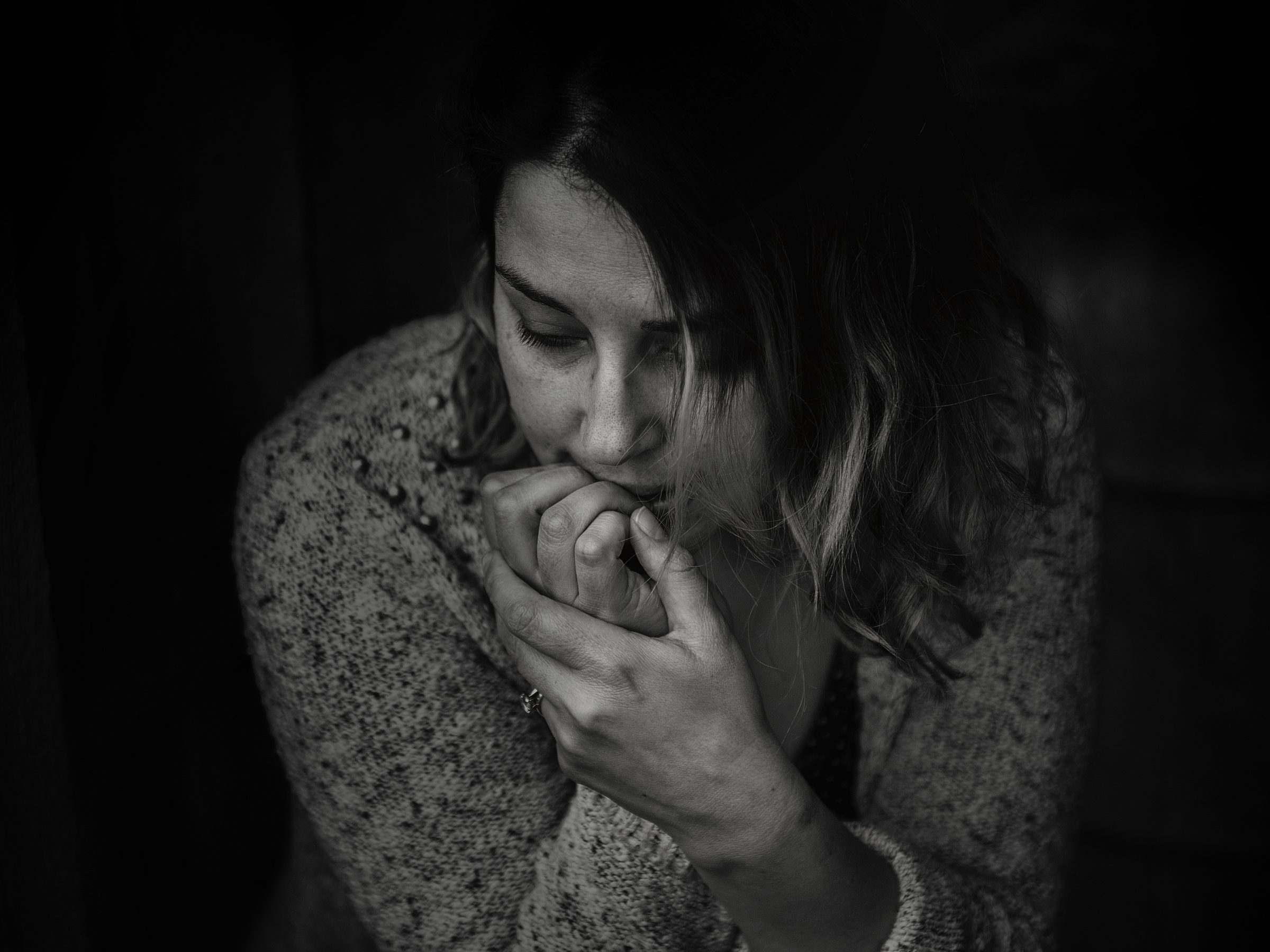stressed woman biting her nails